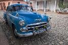 Brenda Tharp Cuba, Trinidad Blue Taxi Parked On Cobblestones